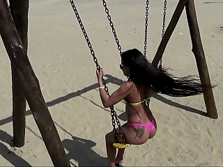 Playful babe swings outdoor..