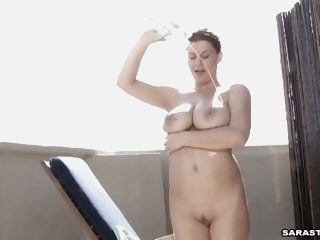 Sara Stone massages her huge..