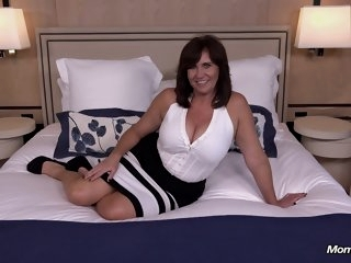 Thick busty Cougar MILF..