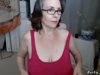 old woman shows her big..