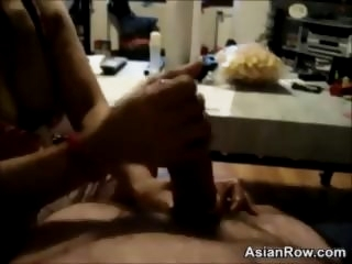 Asian Chick Giving A Handjob..