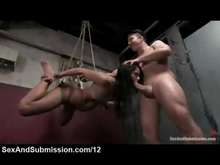 Bound suspended babe fucked..